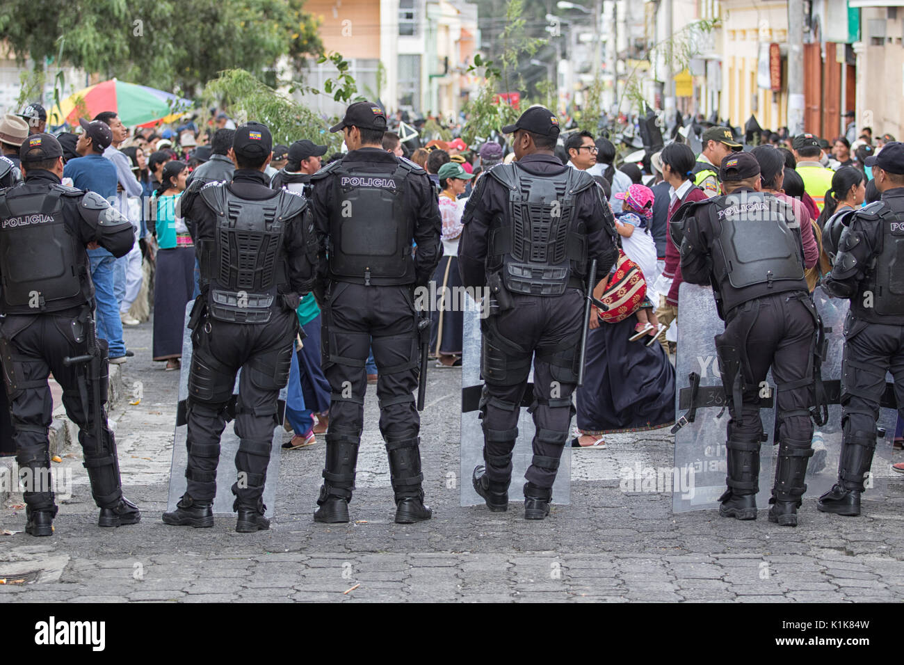 police in riot gear at the Inti Raymi celebrations in Cotacachi Ecuador - Stock Image