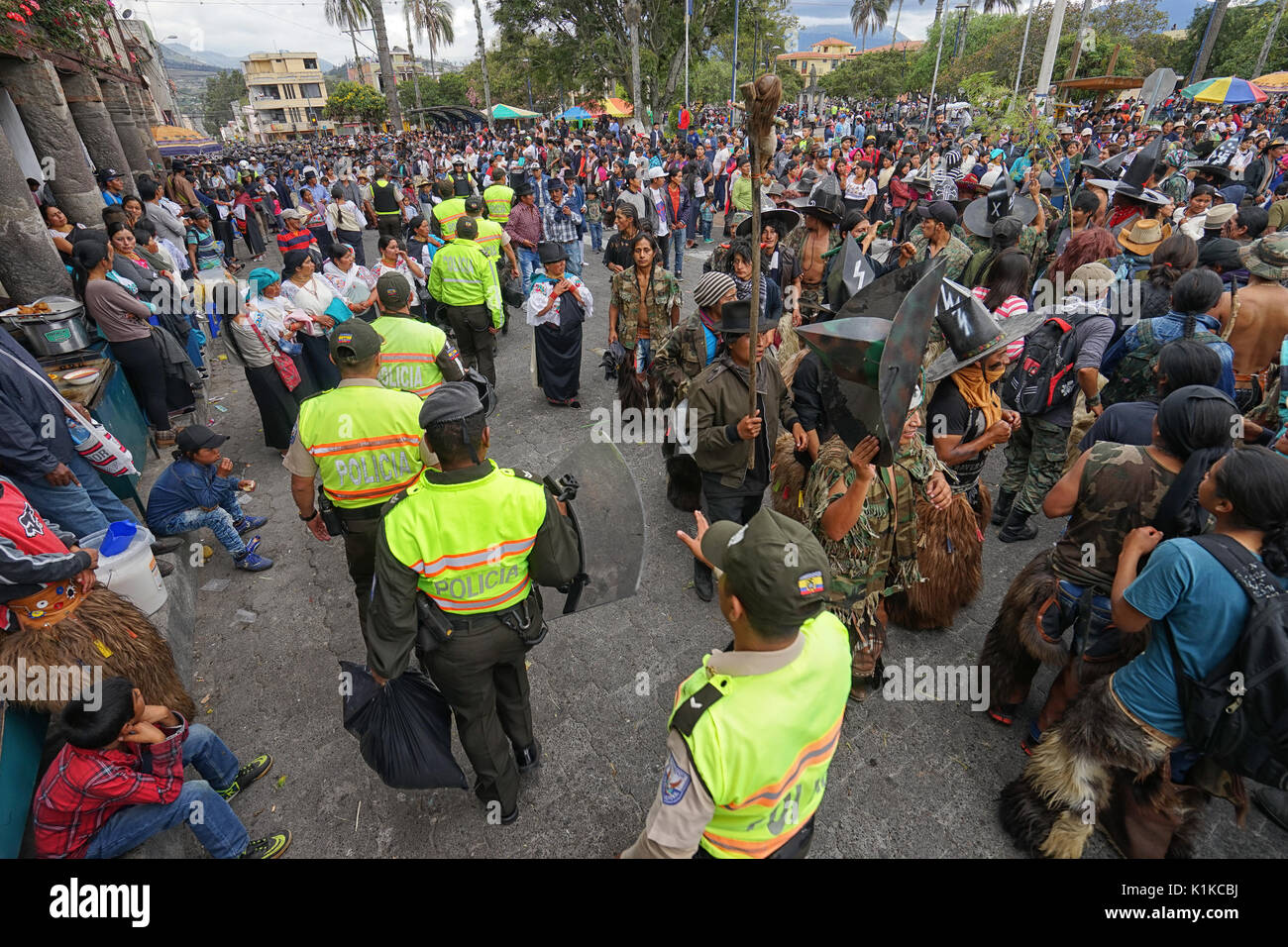 police at the Inti Raymi parade, which can turn violent sometimes in COtacachi Ecuador - Stock Image