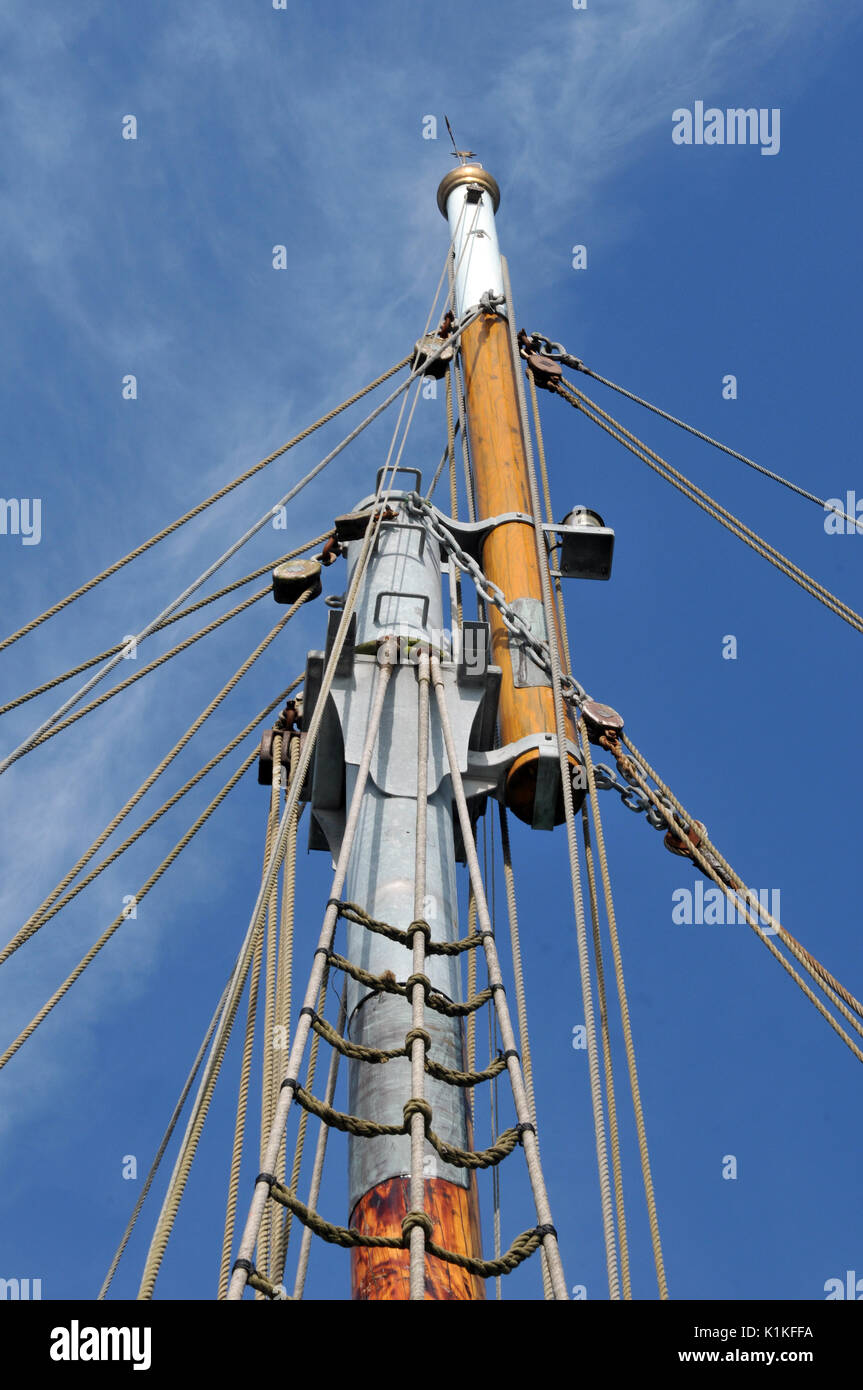 traditional old sailing vessels and deck fittings portholes hammocks and belaying pins ropes and tackles masts and spars booms hatches and decks brass - Stock Image
