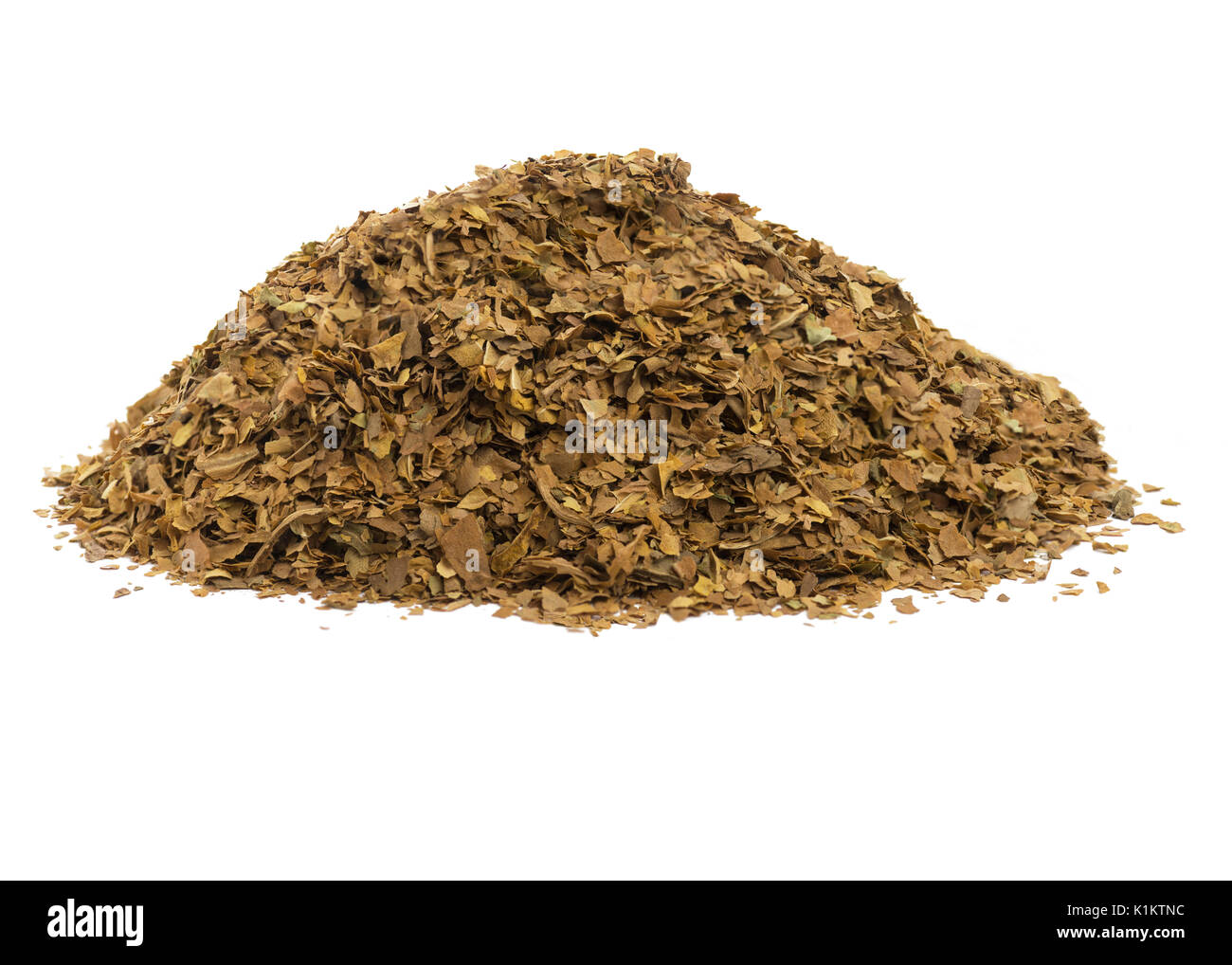 side view image a pile of unprocessed dried tobacco leaves, on a  white isolated background. - Stock Image