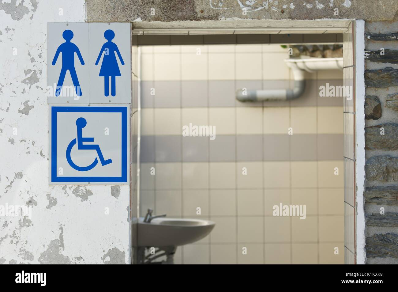 Unisex public toilets with signage in France - Stock Image