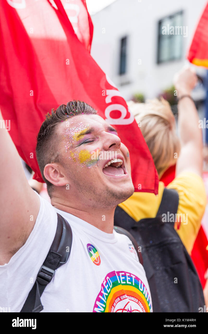 A man with glitter and facepaint cheers at the Cardiff Pride Parade 2017 - Stock Image