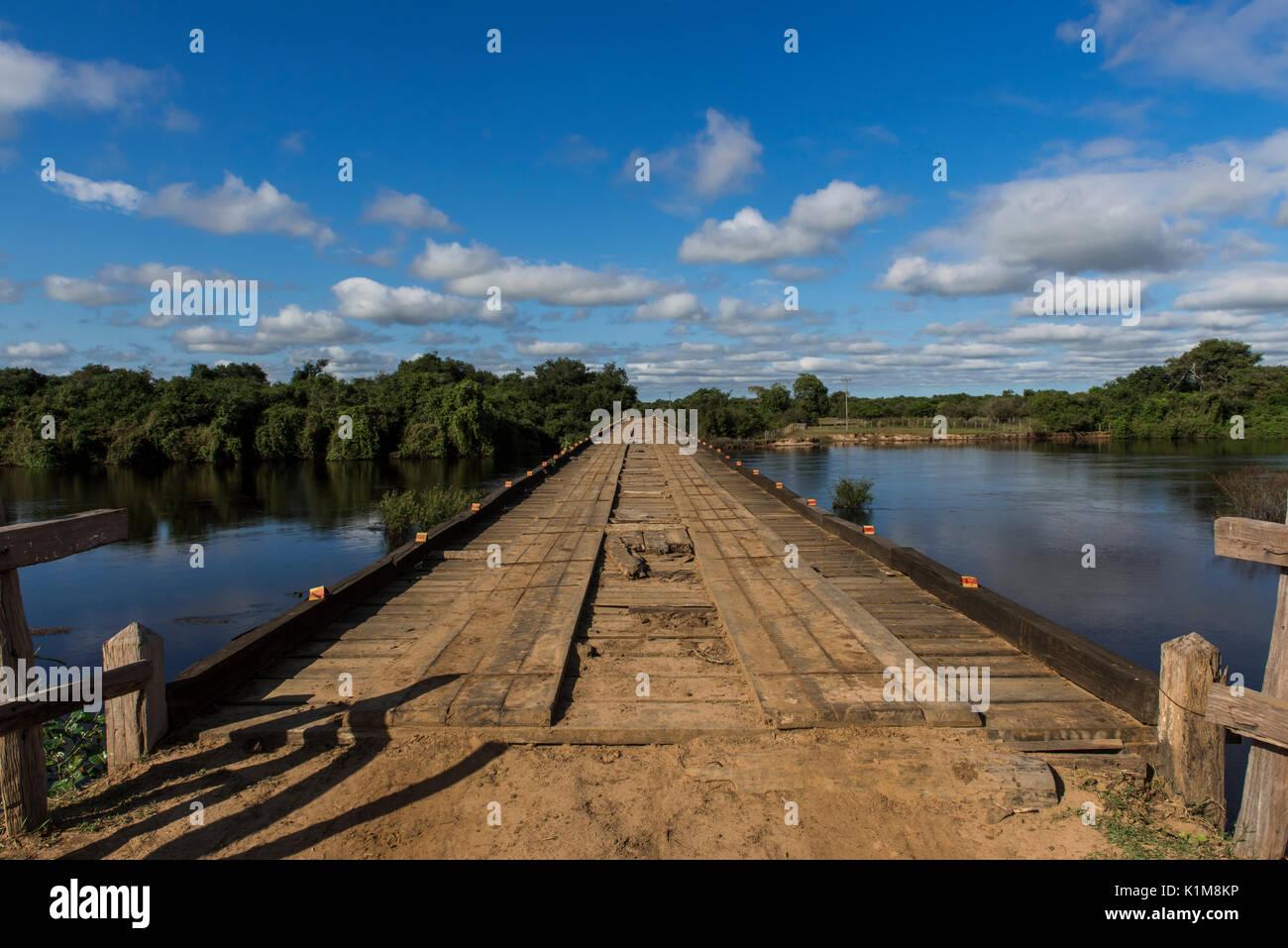 Wooden bridge across the river Rio Negro, Pantanal, Mato Grosso do Sul, Brazil - Stock Image