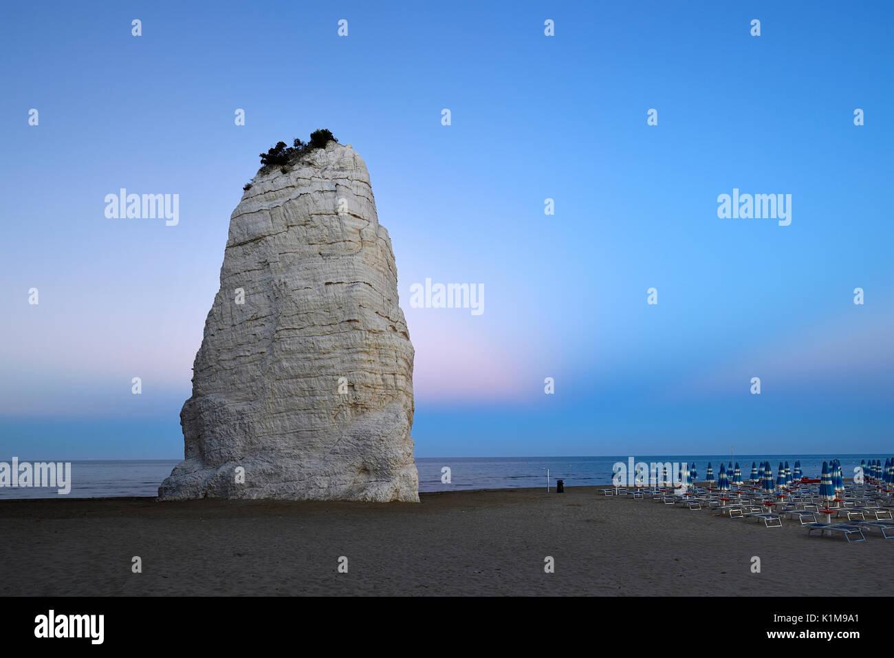 Pizzomunno, limestone cliffs on the beach, landmark of Vieste, Gargano, Foggia Province, Apulia, Italy - Stock Image