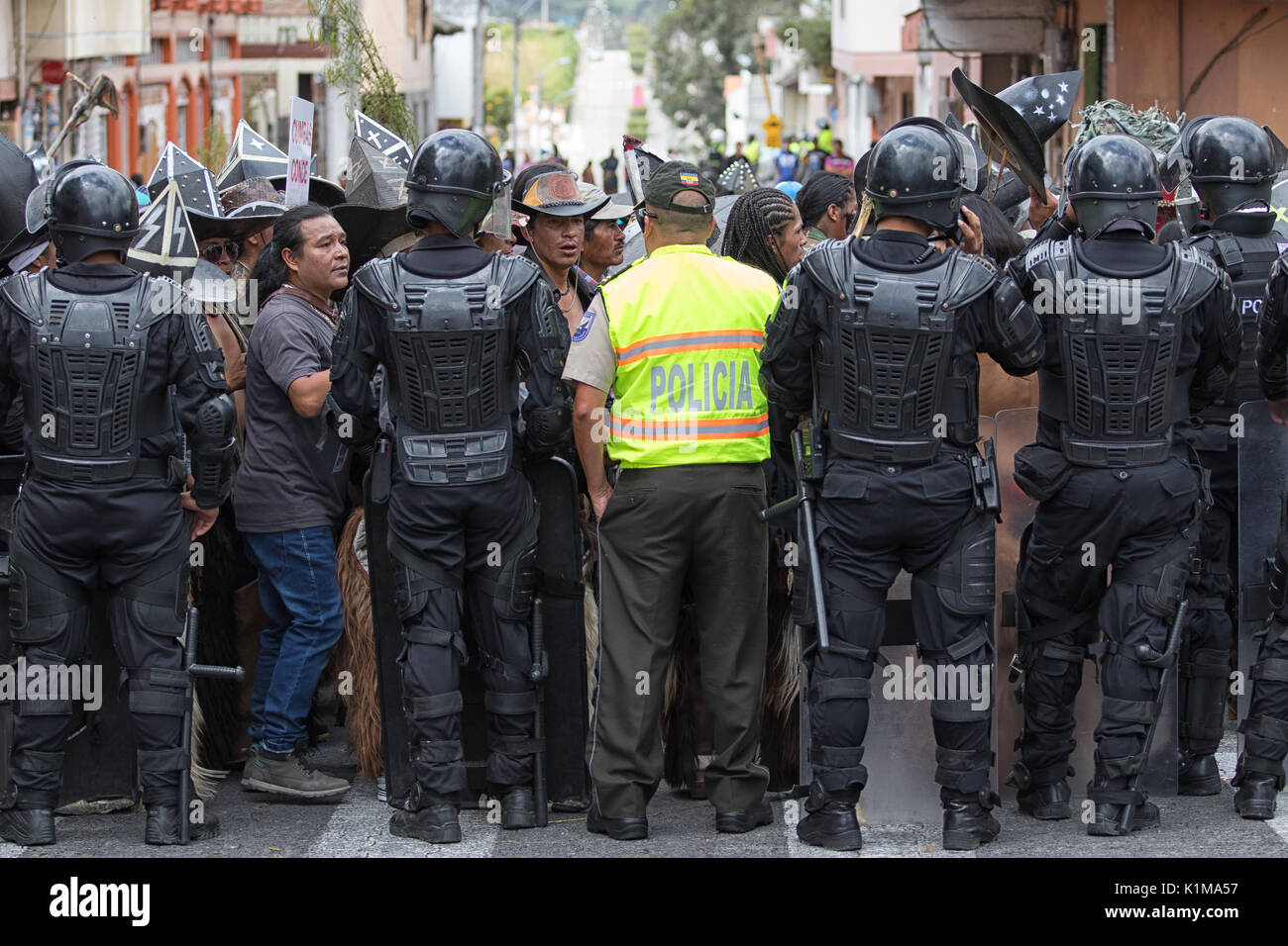 police in riot gear at Inti Raymi parade in Cotacachi Ecuador - Stock Image