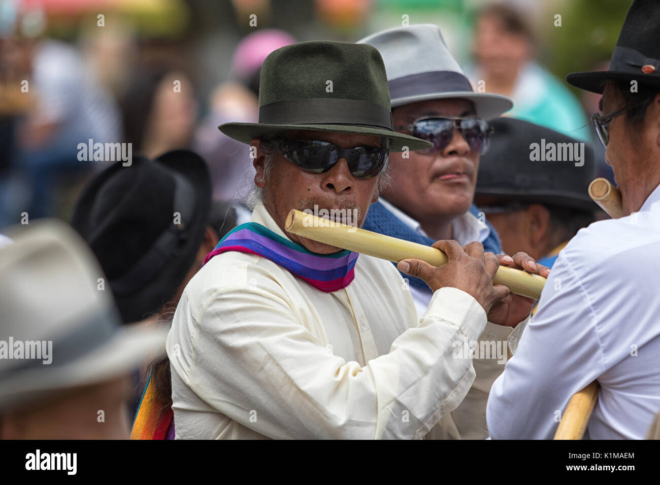 man playing bamboo flute at Inti Raymi dances - Stock Image