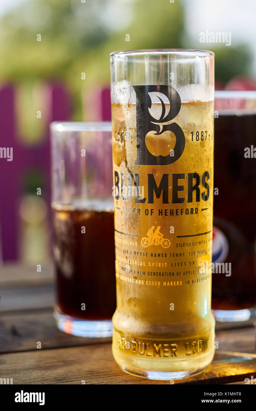 Pint of Bulmers on a hot day with two glass of cola - Stock Image