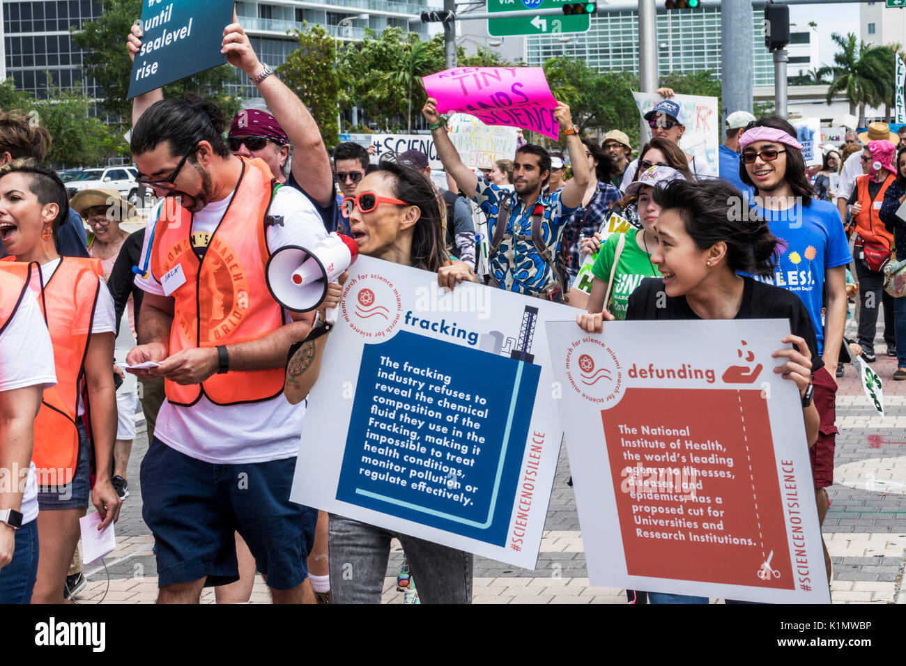 Miami Florida Museum Park March for Science protest rally sign protester marching posters signs fracking Stock Photo
