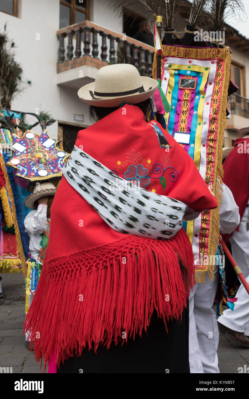 woman in traditional clothing at Corpus Christi parade in Pujili Ecuador - Stock Image