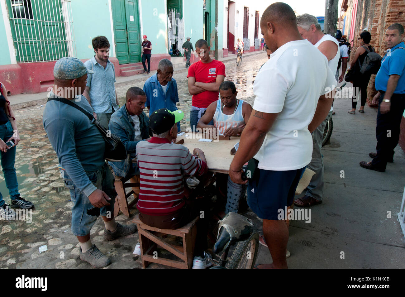 Men playing dominoes on street in Trinidad Cuba - Stock Image