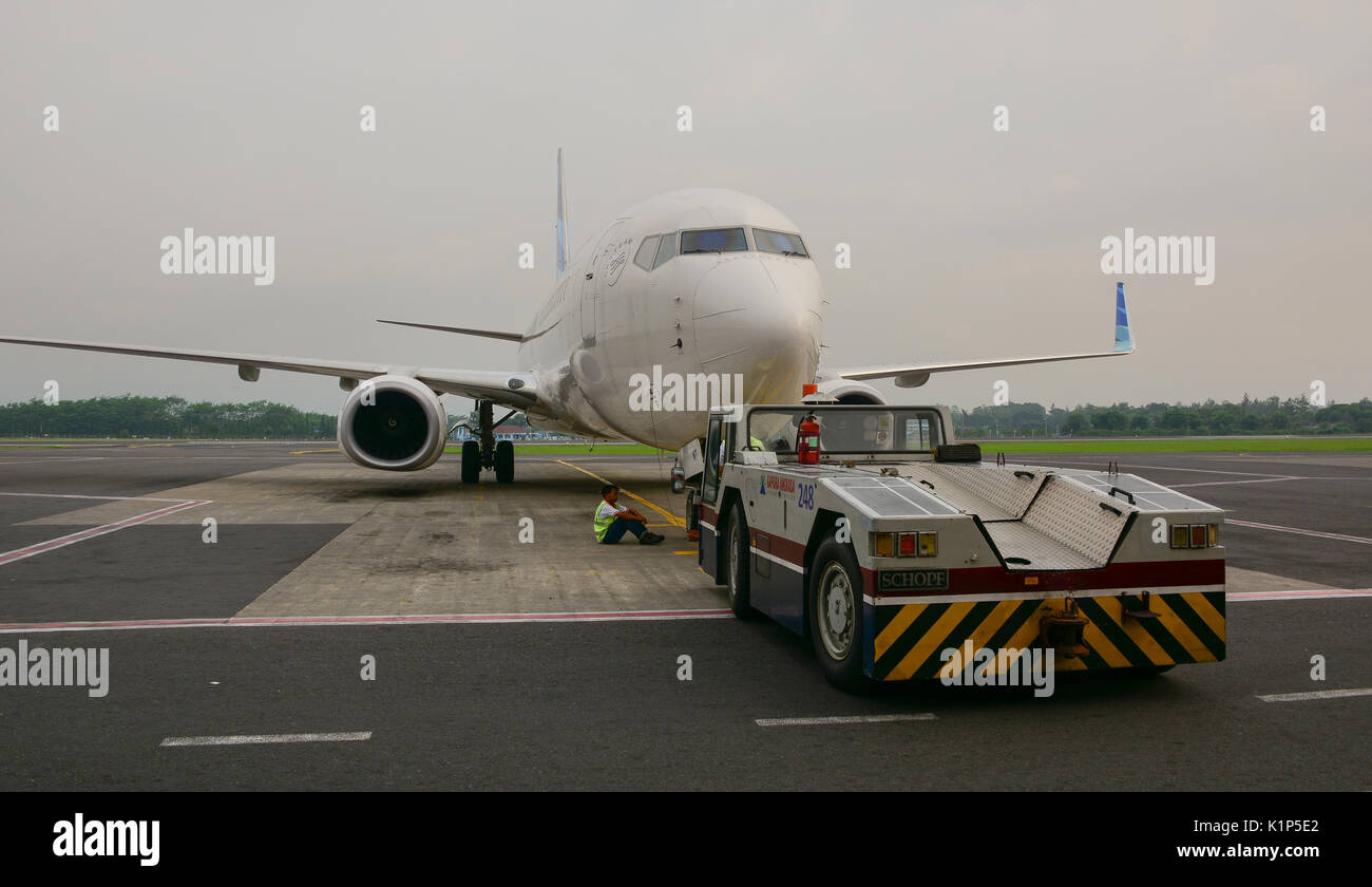 Yogyakarta, Indonesia - Apr 15, 2016. Civil aircraft docking at Adisutjipto Airport in Yogyakarta, Indonesia. Jogja is a bustling town of the most pop - Stock Image