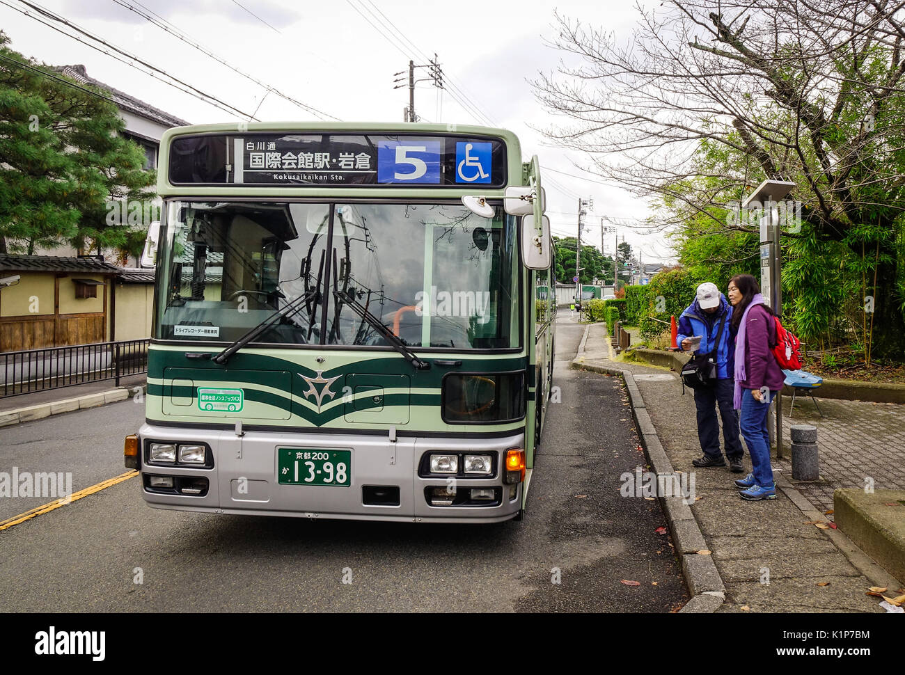 Kyoto, Japan - Nov 28, 2016. A bus stopping at station in Kyoto, Japan. The Kyoto City Buses are major mean of public Stock Photo