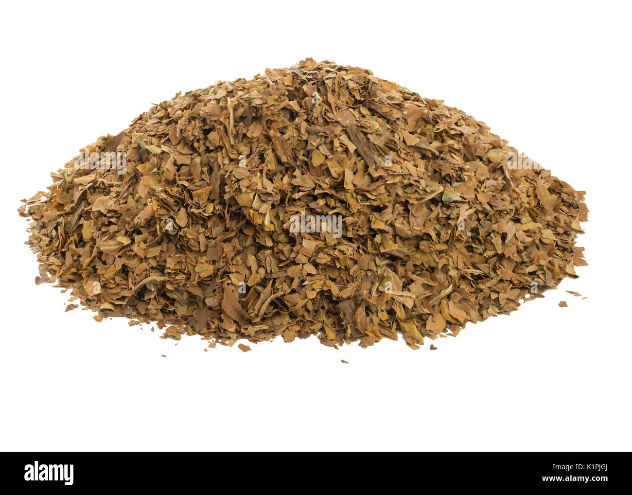 pile of unprocessed dried tobacco leaves, on a  white isolated background. - Stock Image
