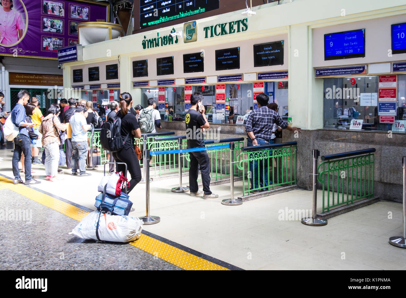 Passengers queueing for tickets, Hua Lamphong station, Bangkok, Thailand Stock Photo