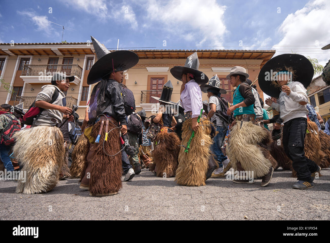June 24,2017 Cotacachi, Ecuador; men participating at Inti Raymi dances on the street - Stock Image