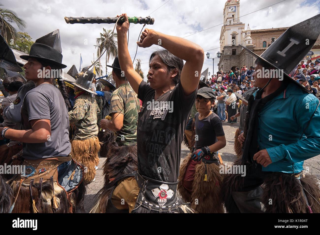 indigenous quechua men at Inti Raymi parade in Cotacachi Ecuador - Stock Image