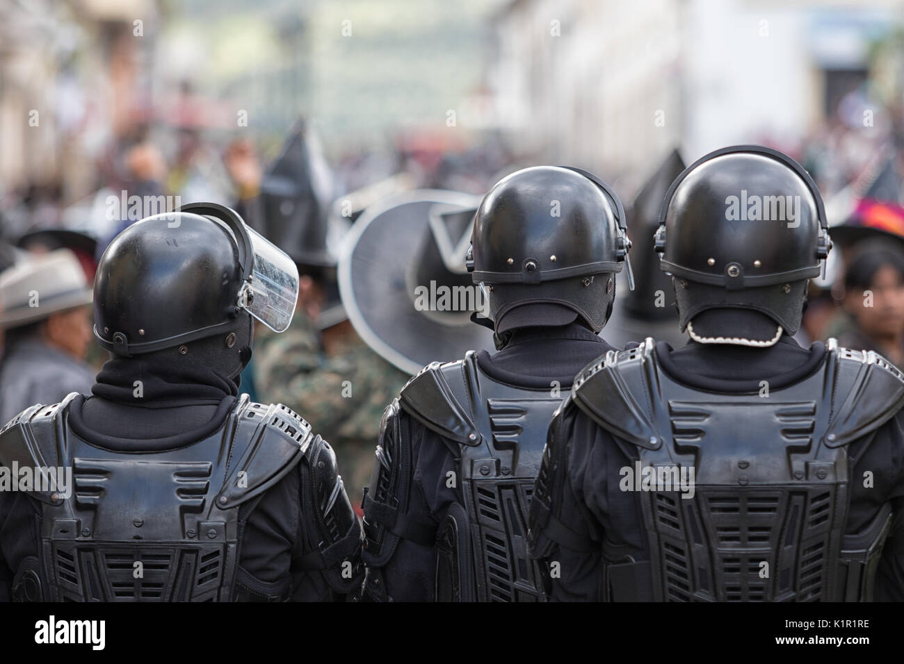 June 24, 2017 Cotacachi, Ecuador: police force on guard during Inti Raymi celebration which occasionally ends up with violence - Stock Image