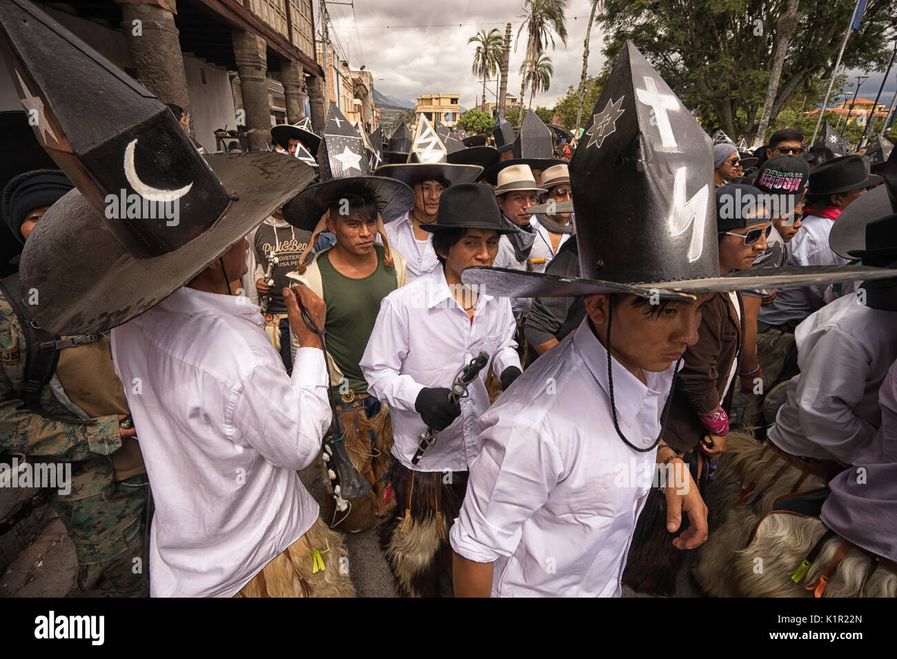 June 24, 2017 Cotacachi, Ecuador: indigenous kichwa men participating in a parade at summer solstice - Stock Image