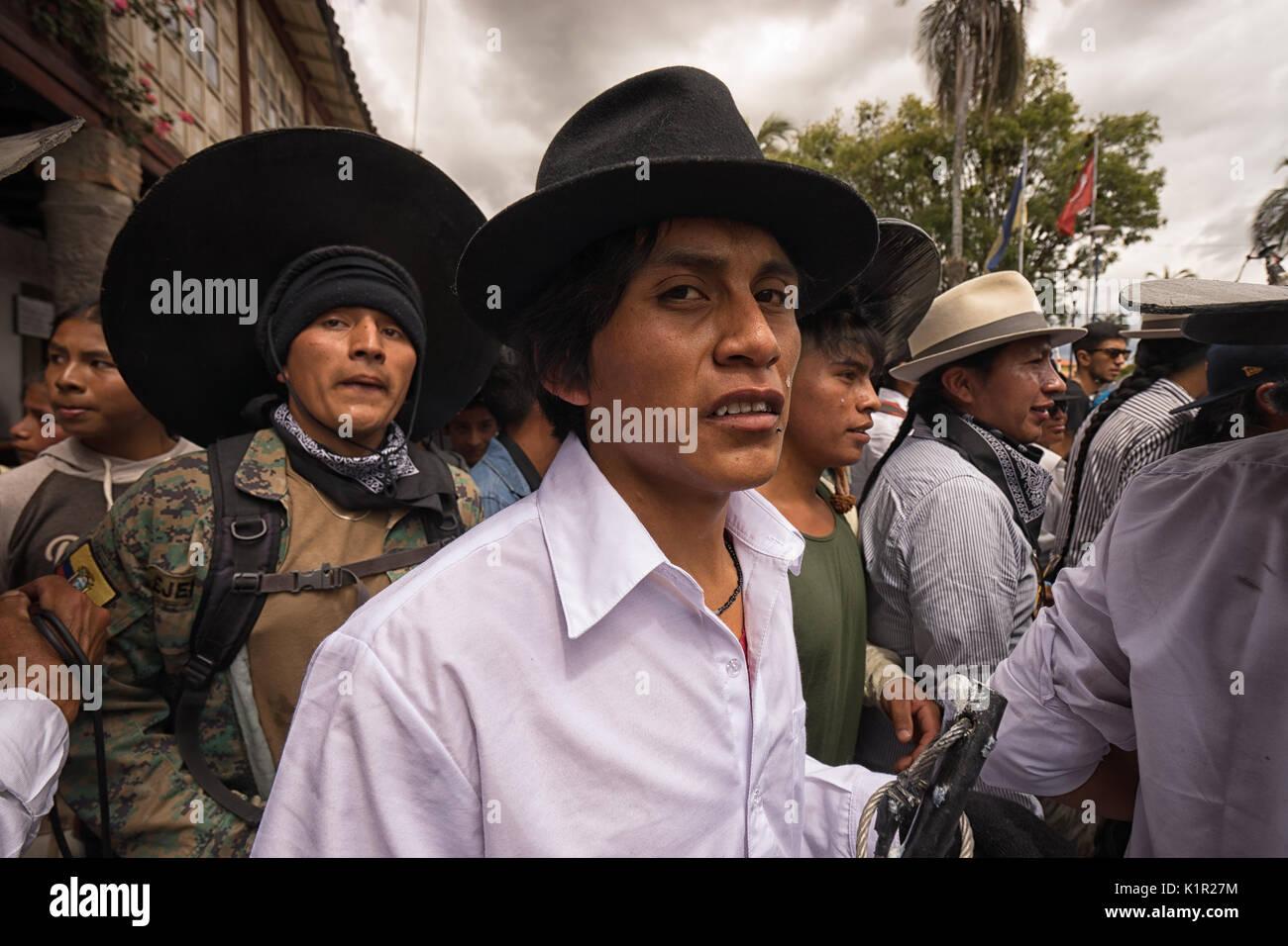 June 24, 2017 Cotacachi, Ecuador: closeup of indigenous kichwa men  participating in a parade at summer solstice - Stock Image