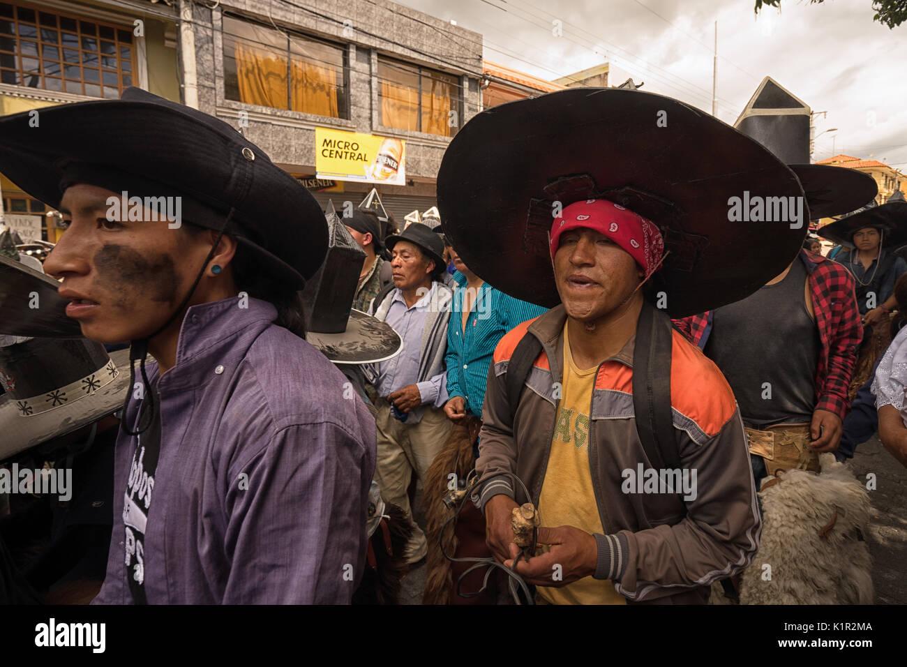 June 24, 2017 Cotacachi, Ecuador: closeup of indigenous kichwa men  participating at an Inti Raymi parade at summer solstice - Stock Image