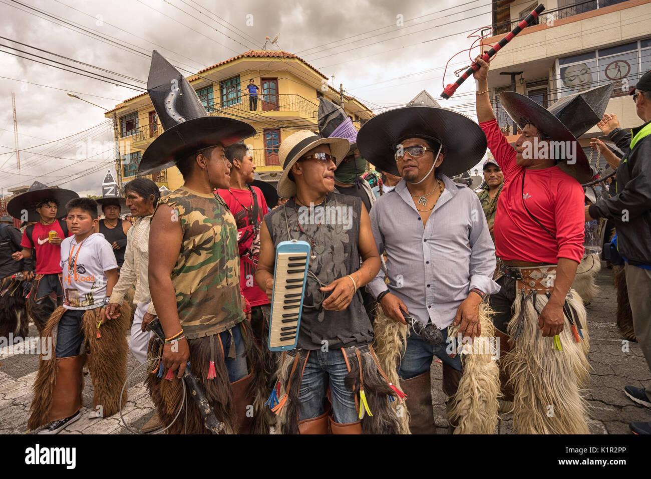 June 24, 2017 Cotacachi, Ecuador: a group of indigenous kichwa men  participating at an Inti Raymi parade at summer solstice - Stock Image