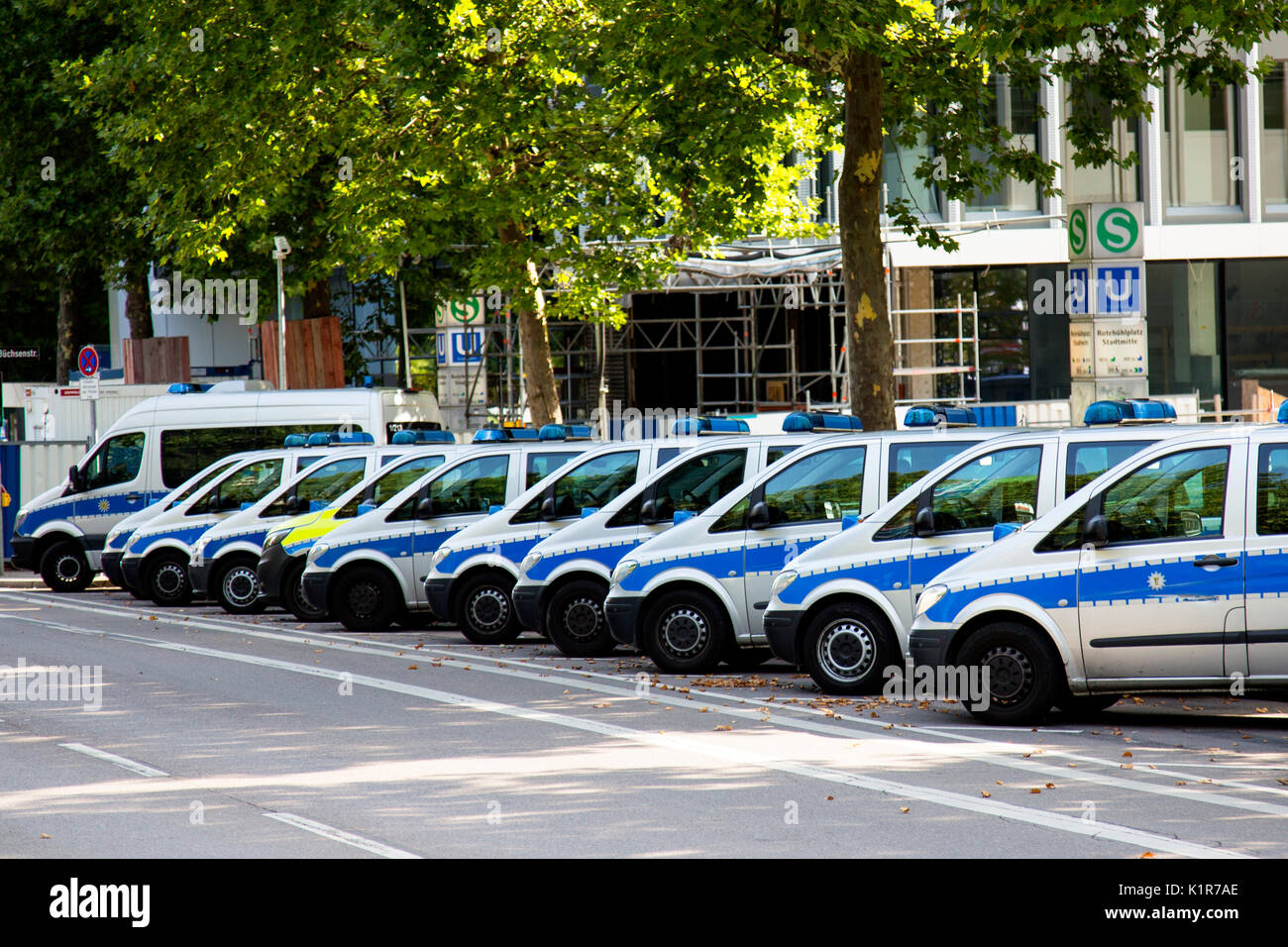 A line of Mercedes police cars parked outside a place station on a street in Stuttgart, Germany, Europe Stock Photo