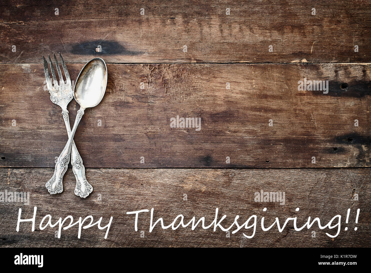 Antique Silverware Spoon And Fork Happy Thanksgiving Text Over A Rustic Old Wooden Background Image Shot From Overhead