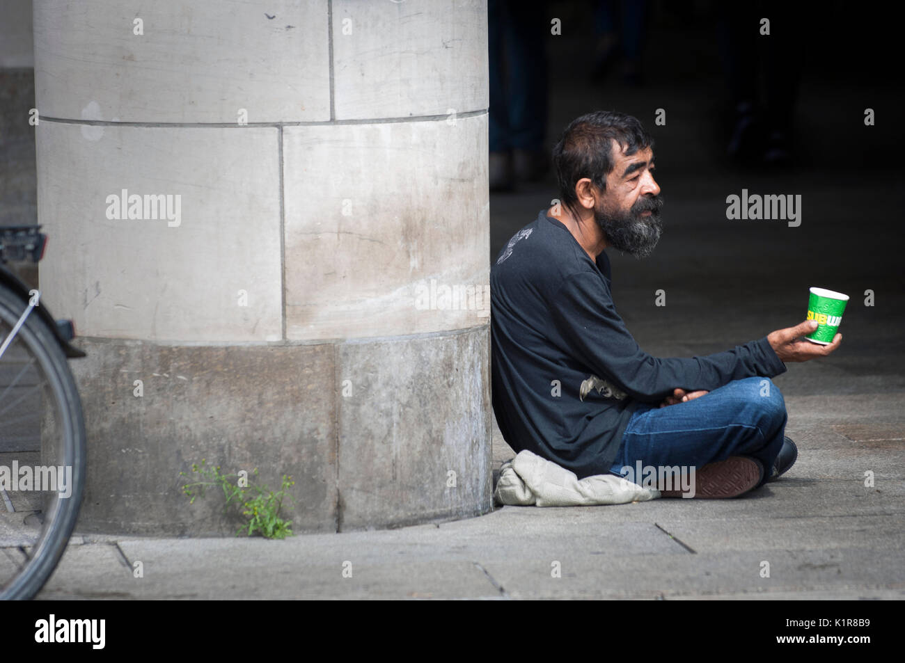 Begging on the streets of German City Erfurt in the regional state of Thuringia, - Stock Image