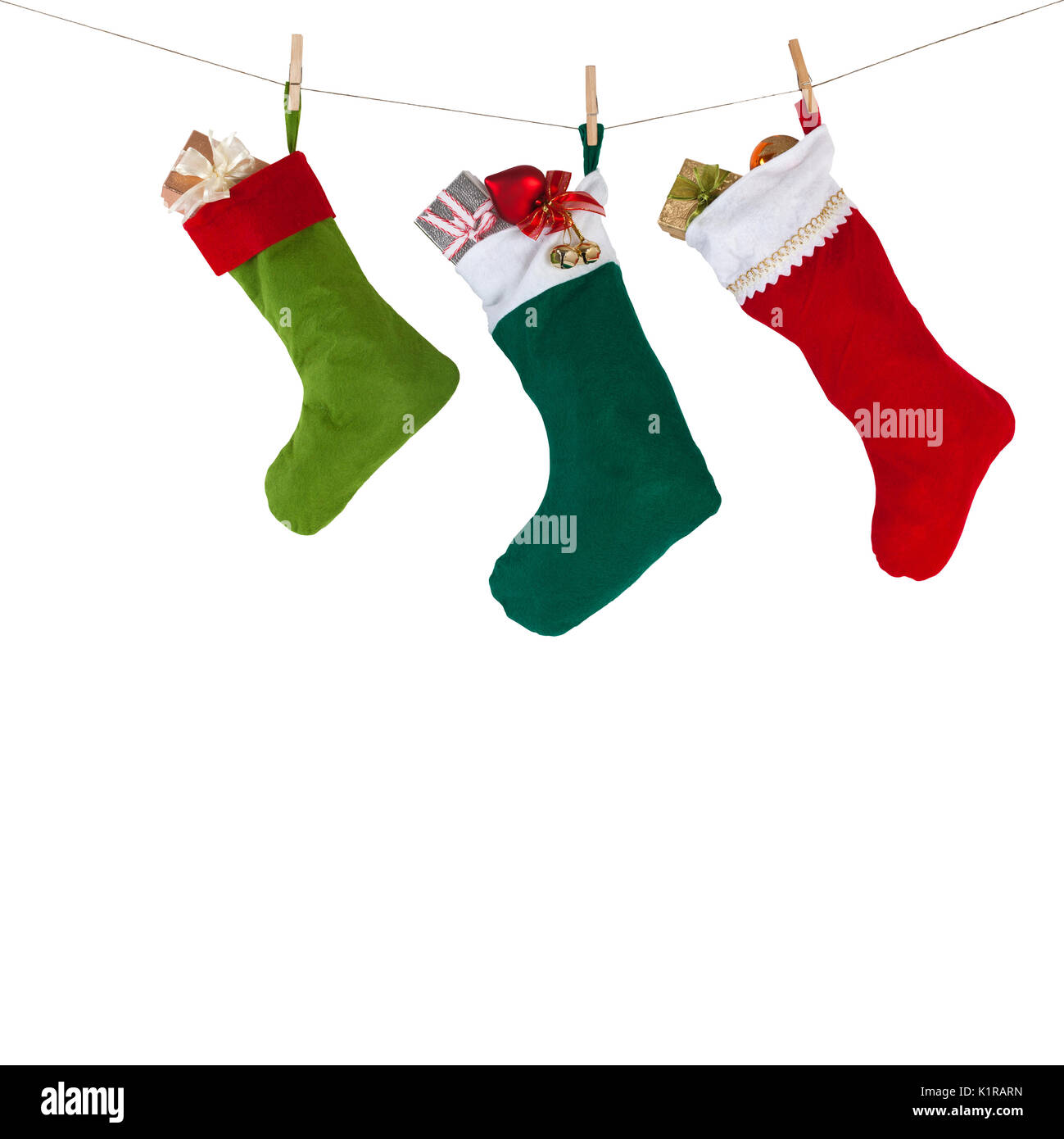 Christmas Socks Hanging On The Rope With Clothespins