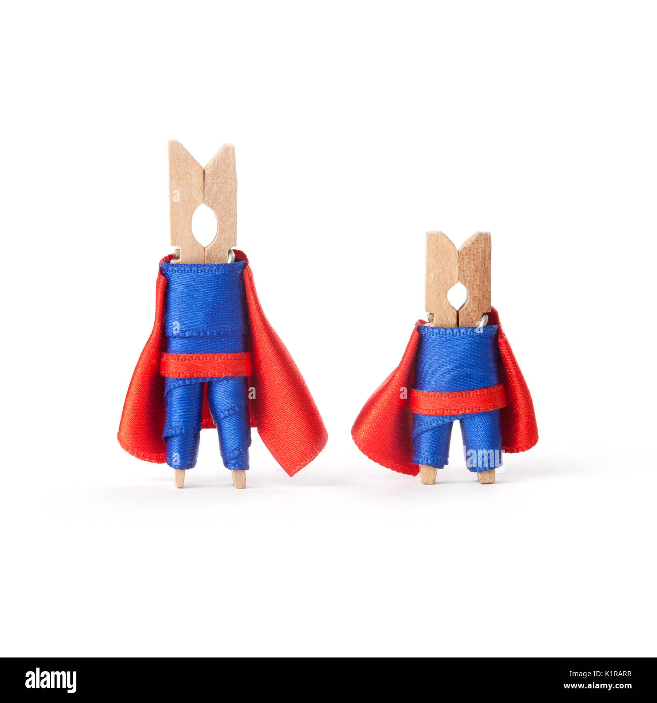 Teamwork, successful business people concept. Superheroes clothespins. white background - Stock Image