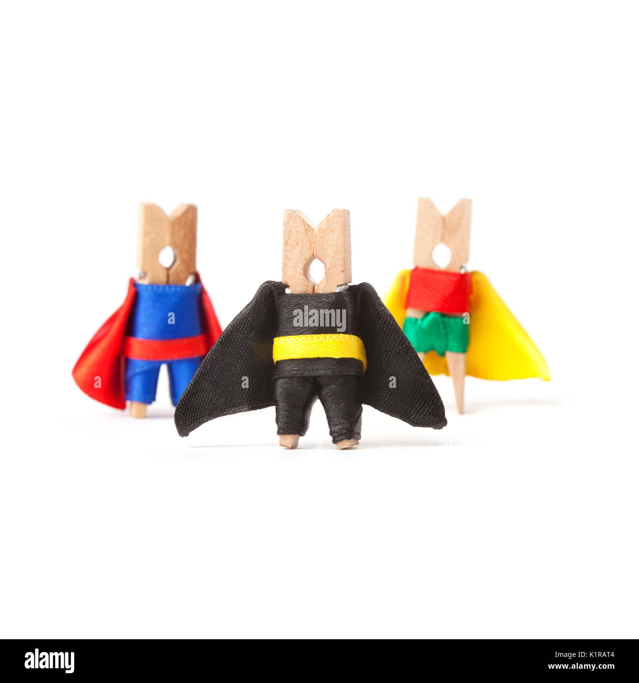Team building, teamwork and leader concept. Superheroes clothespins. White background - Stock Image