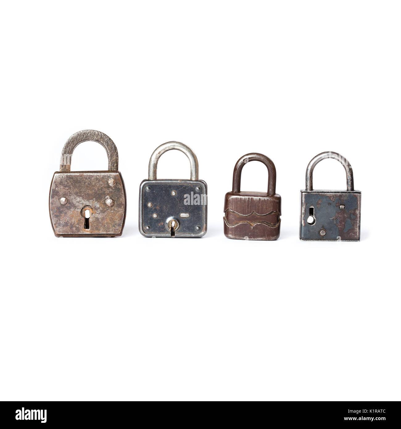 Different kinds padlocks with key hole. White background Stock Photo