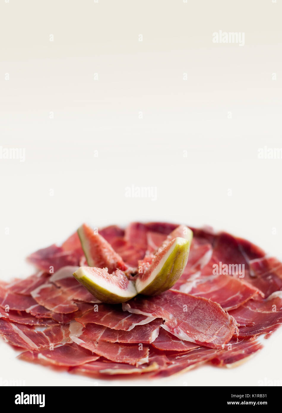 Sliced jamon with figs. Traditional tapas, dish from Spain.  isolated. - Stock Image