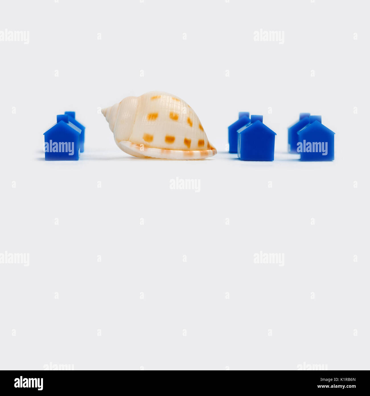 Abstract town landscape with blue houses and snail. gray background - Stock Image