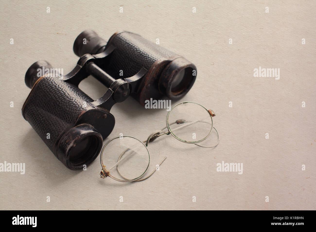 binocular and glasses - Stock Image