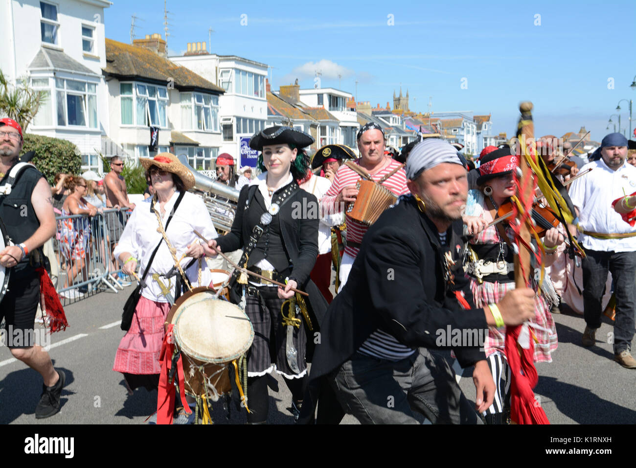 Penzance, Cornwall, UK. 27th August 2017. Pirates gather on the seafront at Penzance in an attempt to break the Guiness world record for the greatest number of pirates in place.  In 2014 Penzance narrowly failed to regain the title from Hastings, as they were 77 pirates short – most of whom were drinking outside the seafront pubs – and hence outside of the official counting zone.  They need 15000 pirates to win the event this year.     Credit: Simon Maycock/Alamy Live News Stock Photo