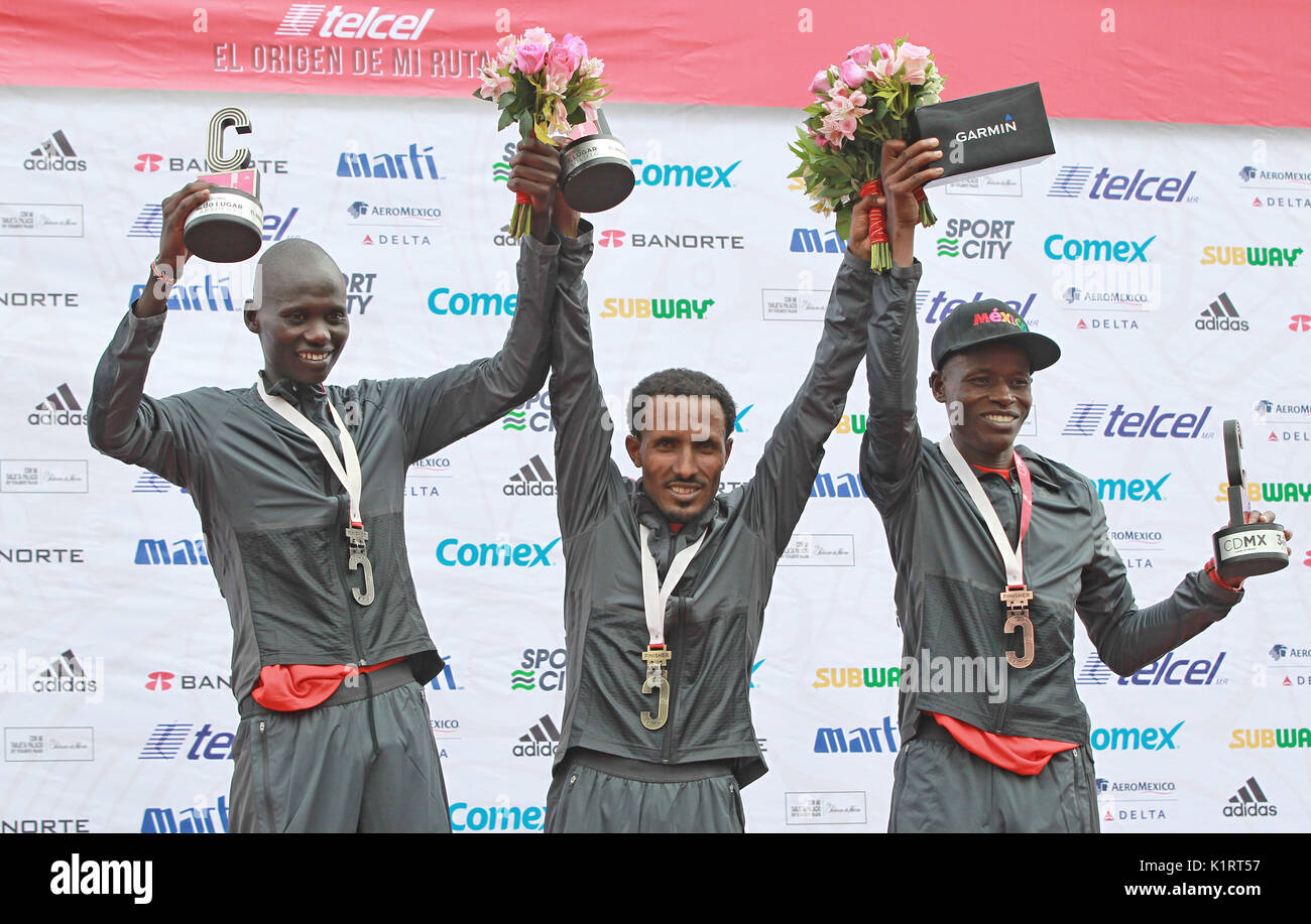 Ethiopian Fikadu Kebede (C) winner of the men's category, poses with Isaac Korin (L), second, and Rodgers Ondati (R), third, arrives in first position to the finish line during the Mexico City Marathon in Mexico, 27 August 2017. Kebede made a time of 2:17:28. EFE/Mario Guzman - Stock Image