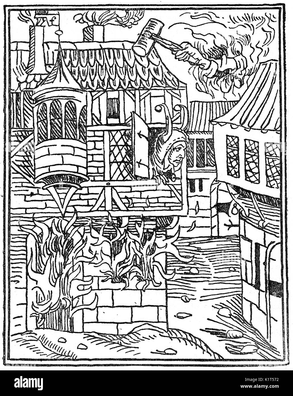 A 15th century (1494) symbolic allegory woodcut showing a Medieval street and buildings with a fool whose house is on fire. Above him the hand of god (or fate) adds to his destruction with a hammer or mallet. (The 'all seeing eye' is hidden  just above the cuff and a flag flies above his house with the letter F for fool) - Stock Image