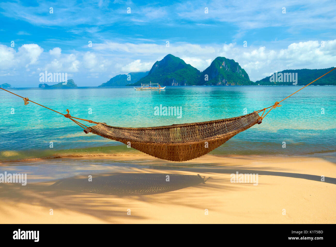 A hammock at the beach - El Nido, Philippines - Stock Image