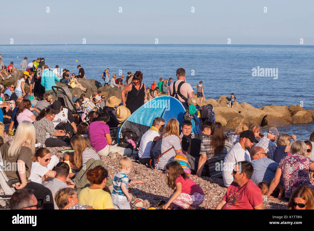 A large crowd packed onto the beach at,Sidmouth, waiting for the Red Arrows. - Stock Image
