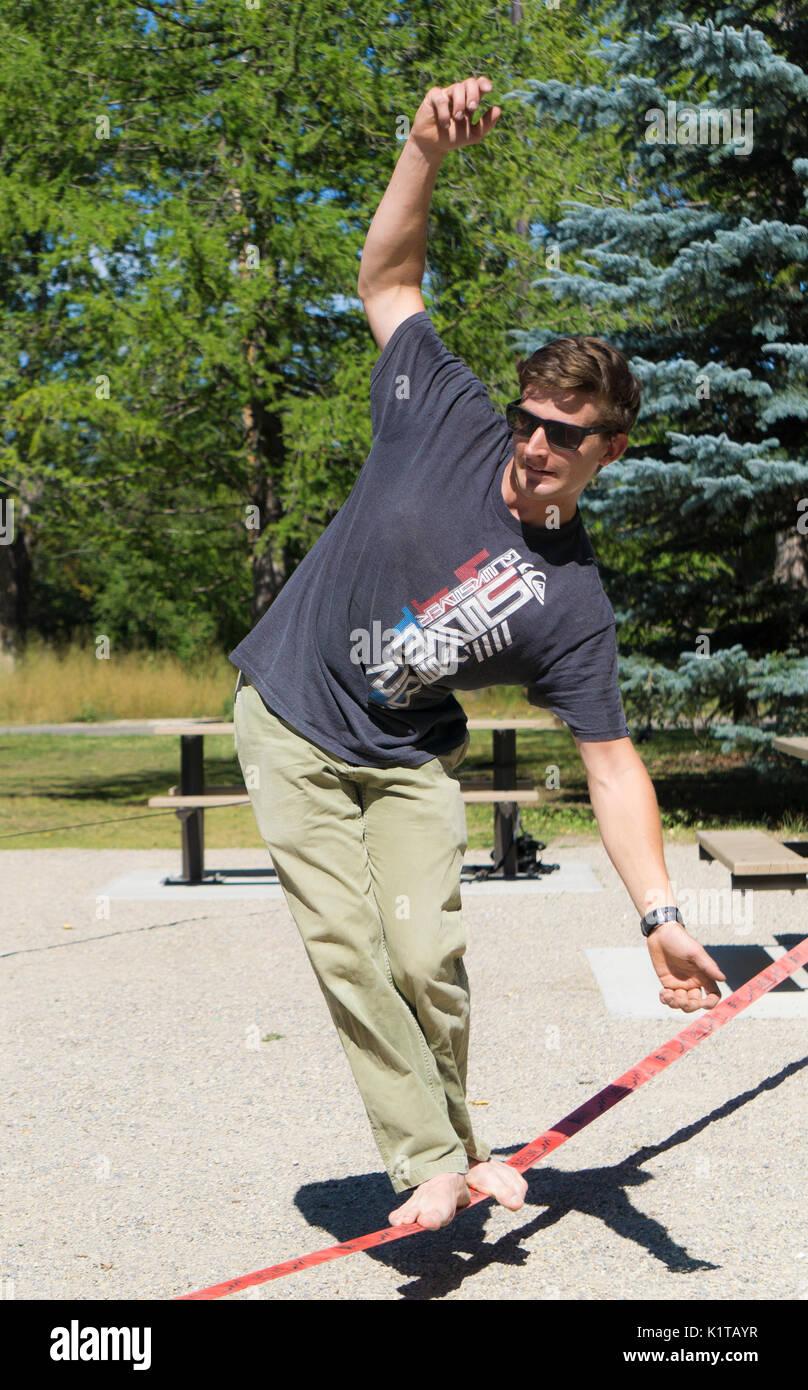 Slacklining at Bowness Park Calgary AB - Stock Image