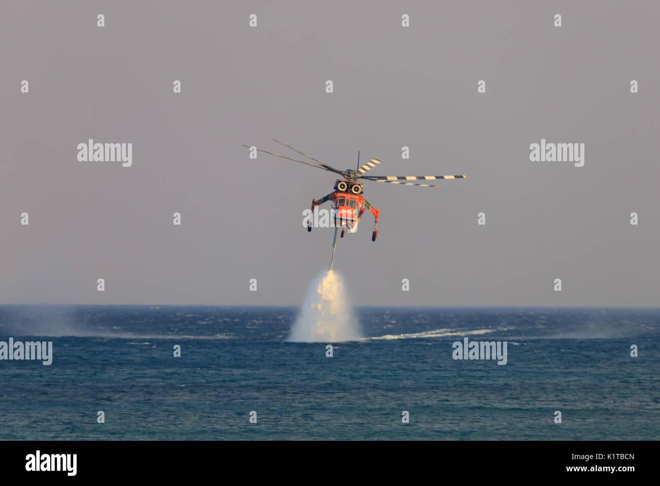 Zakynthos/Greece August 12, 2017: sikorsky s-64e skycrane, fighting against fire at Zakynthos. - Stock Image