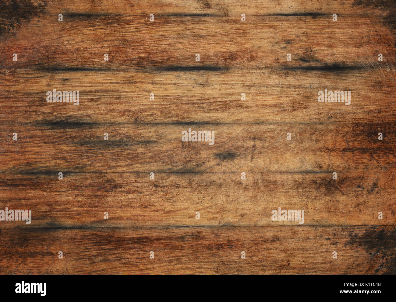 Vintage brown barrel wooden planks background texture with scratches and black stains over wood grain of old aged oak barrel bottom, close up - Stock Image