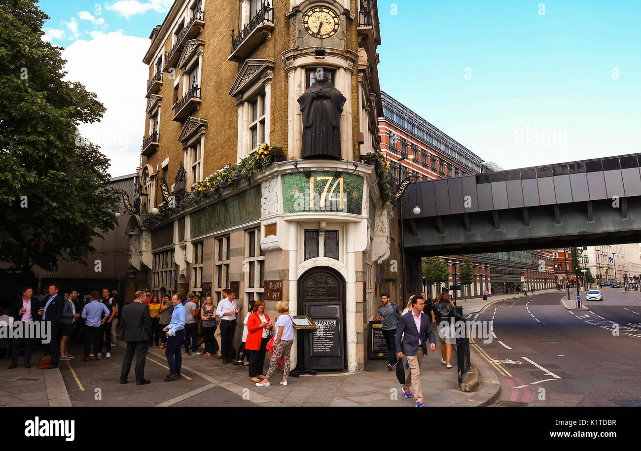 Traditional pub - The Black Friar - and small front of house, at Blackfriars bridge in London, England Stock Photo