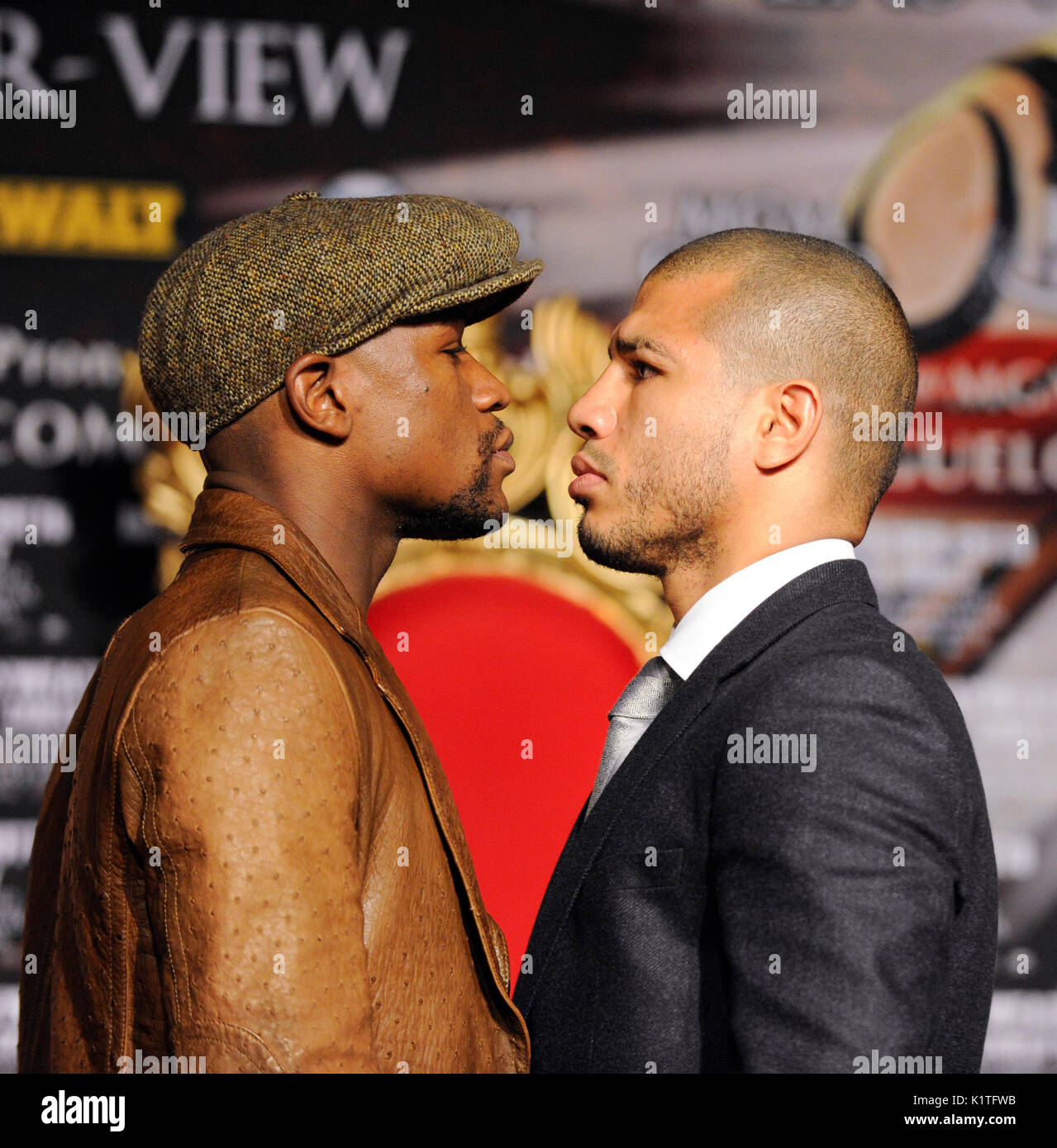 US boxer Floyd Mayweather (L) WBA Super Welterweight World Champion Miguel Cotto Puerto Rico faceoff during press conference Grauman's Chinese Theatre Hollywood March 1,2012. Mayweather Cotto will meet WBA Super Welterweight World Championship fight May 5 MGM Grand Las Vegas. - Stock Image