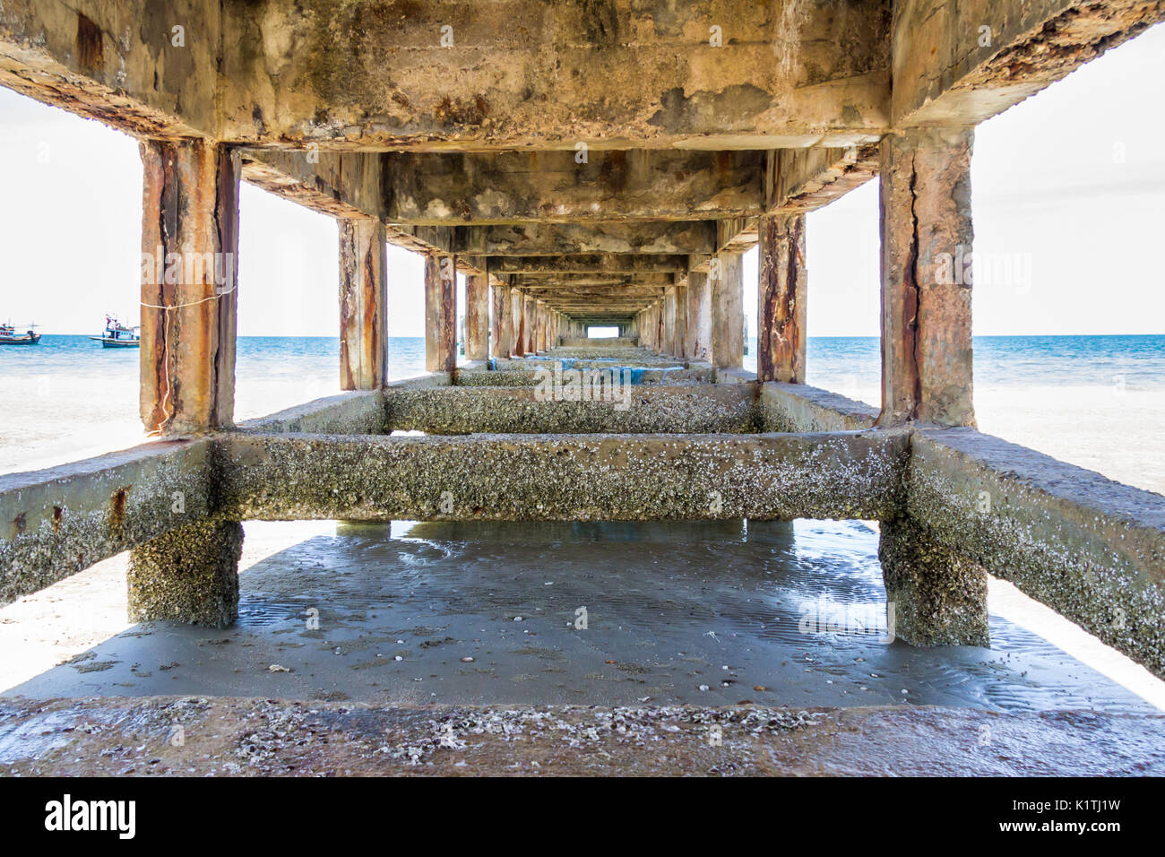 Vanishing point underneath a concrete pier - Stock Image