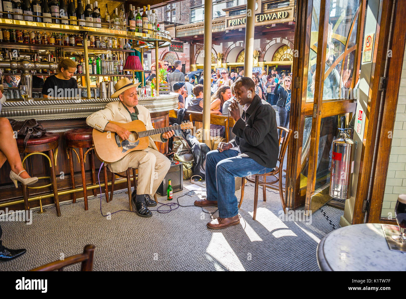 Soho London pub, two blues musicians perform inside the Cafe Boheme in Old Compton Street on a summer afternoon, Soho, London, UK. - Stock Image