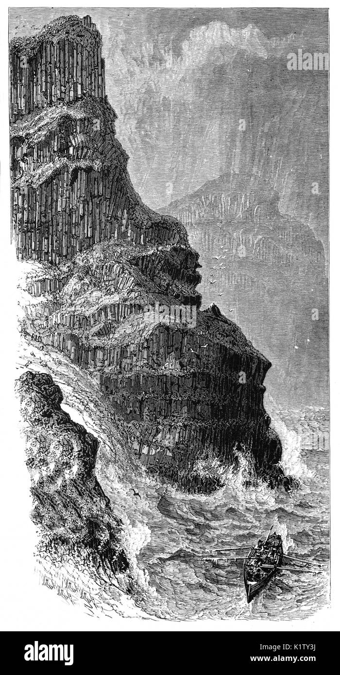 1870: A whaler in rough seas below Pleaskin Head, part of the Giant's Causeway, an area of about 40,000 interlocking Stock Photo