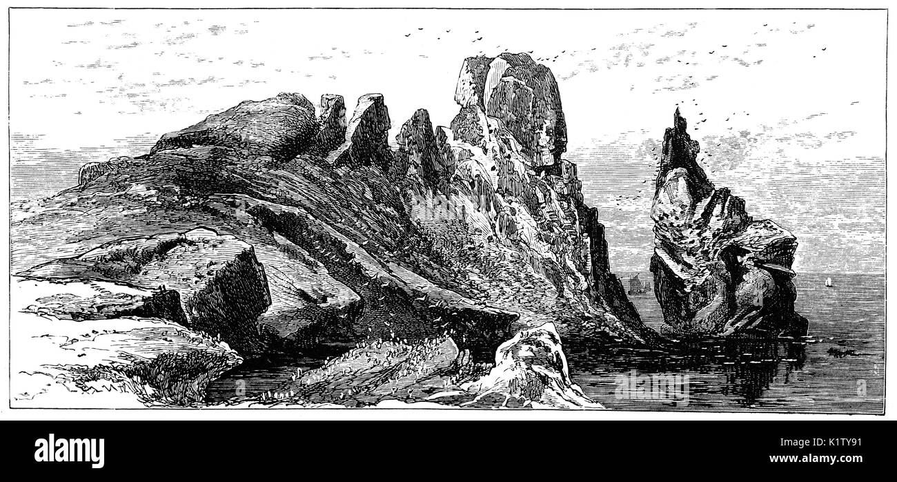 1870: The huge freestanding rock called 'the Stack', at the northeastern corner of the island,  host to a large variety of seabirds, on Ireland's Eye, A small uninhabited island off the coast of County Dublin,  situated directly north of Howth Harbour, Ireland, - Stock Image