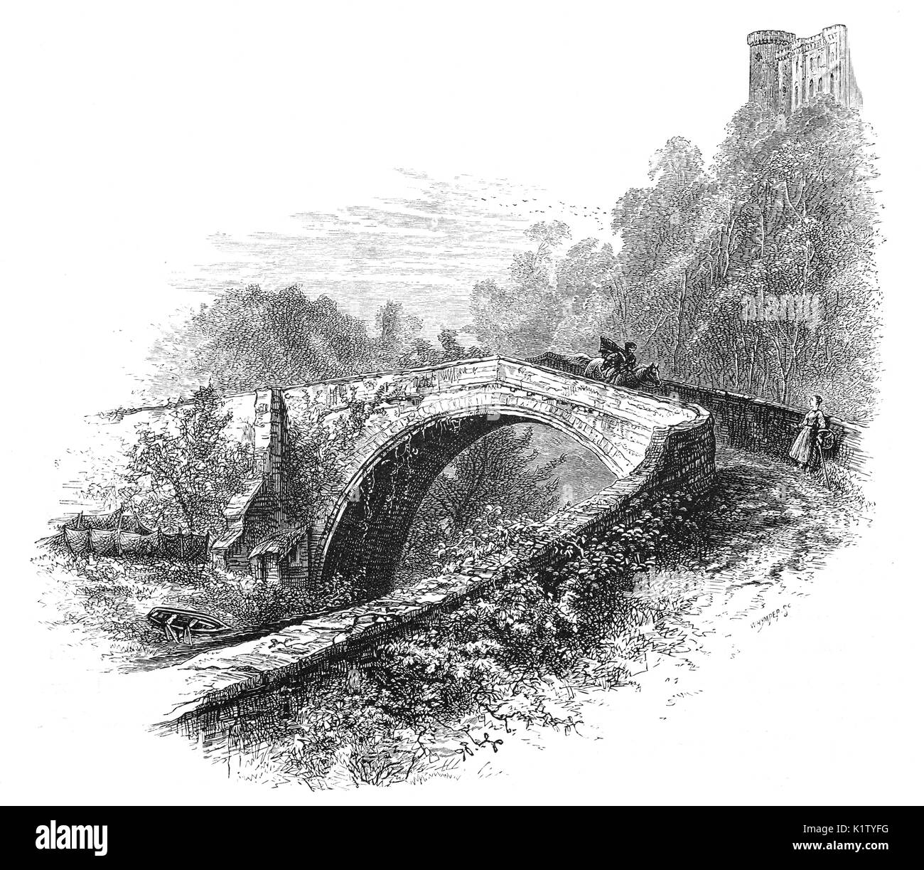 1870: A horseman crossing the medieval Twizell bridge built in 1511, two years before the Battle of Flodden, provided the only dry crossing of the River Till between the Tweed and Etal.  Above it the ruins of Twizell Castle, aka Twizel,  Tillmouth Park, Northumberland, northern England. - Stock Image